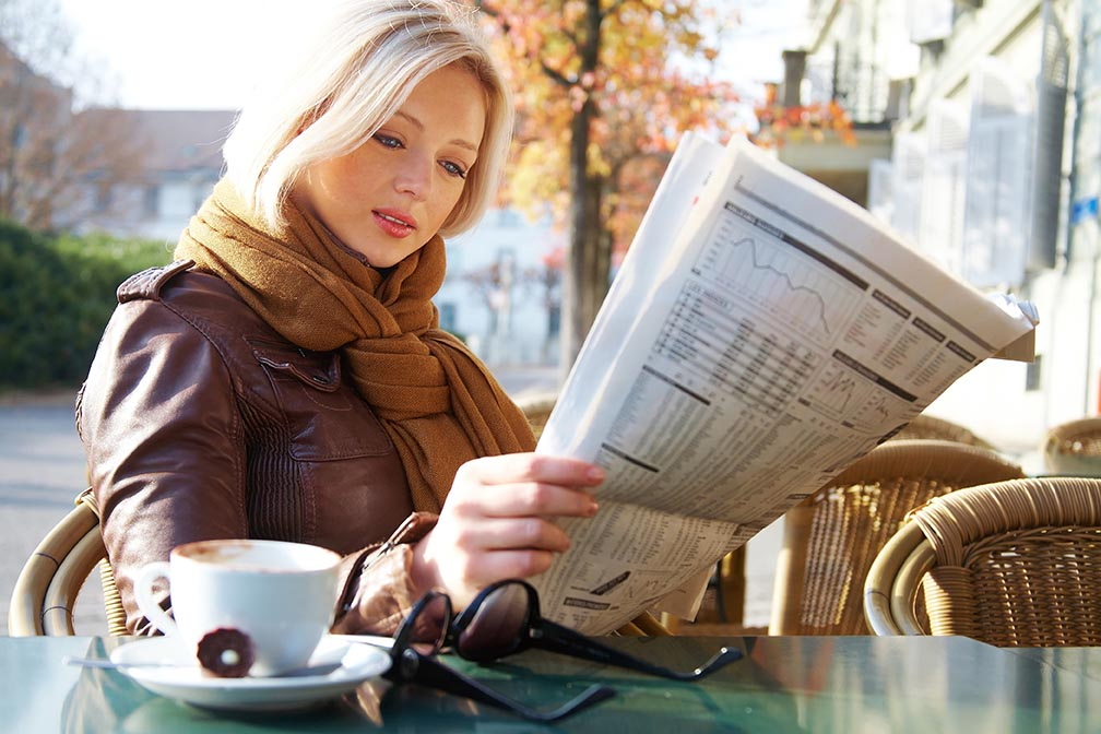 How To Get Free Publicity Woman Reading Newspaper